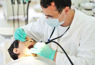 Dentist working on child