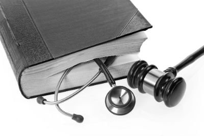Image of legal objects including a book on law and a gavel.